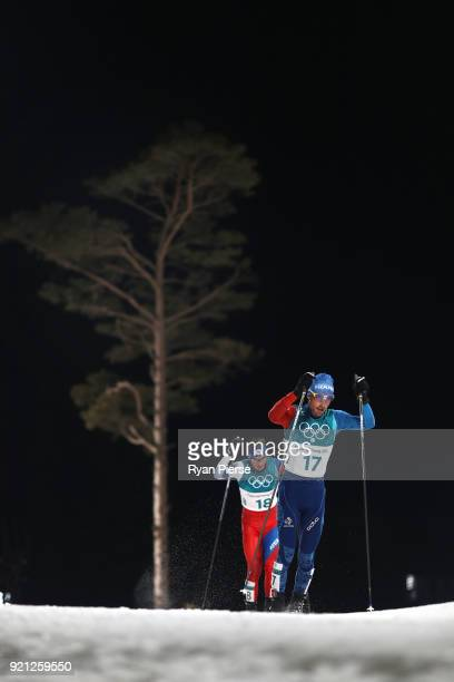 Francois Braud of France and Tomas Portyk of the Czech Republic compete during the Nordic Combined Individual Gundersen 10km CrossCountry on day...