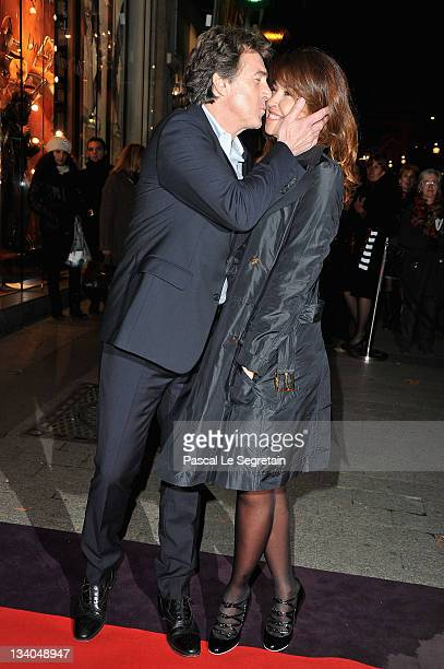 Francois Cluzet and wife Narjiss attend the Lancel celebration of '135 Years Of French Legerete' Hosted By Sienna Miller on November 24 2011 in Paris...