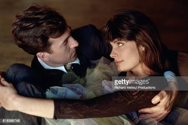 Francois Cluzet embraces Marie Trintignant The two actors have appeared in many films together