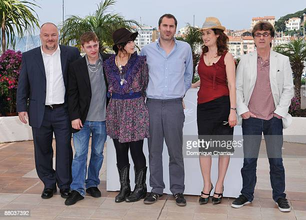 Francois Cluzet, Emmanuelle Devos, director Xavier Giannoli, Soko, Vincent Rottiers and Brice Fournier attend the In the Beginning Photo Call at the...