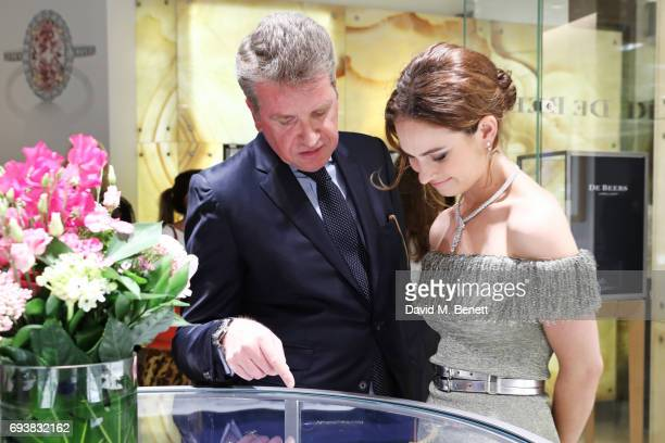 Francois Delage CEO of De Beers Diamond Jewellers and Lily James attend the De Beers Grand Opening at Harrods on June 8 2017 in London United Kingdom