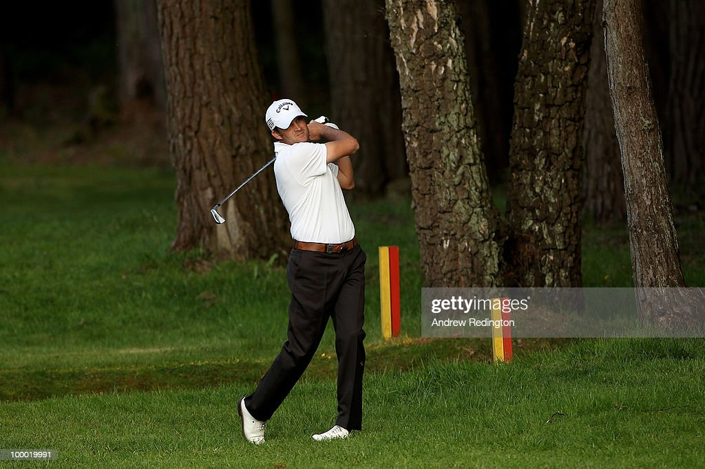 Francois Delamontagne of France hits an approach shot during the first round of the BMW PGA Championship on the West Course at Wentworth on May 20, 2010 in Virginia Water, England.
