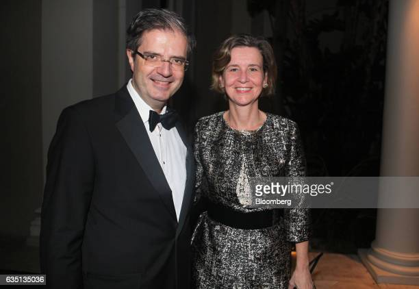 Francois Delattre France's ambassador to the US left and wife Sophie Delattre stand for a photograph at the Breakers Hotel in Palm Beach Florida US...