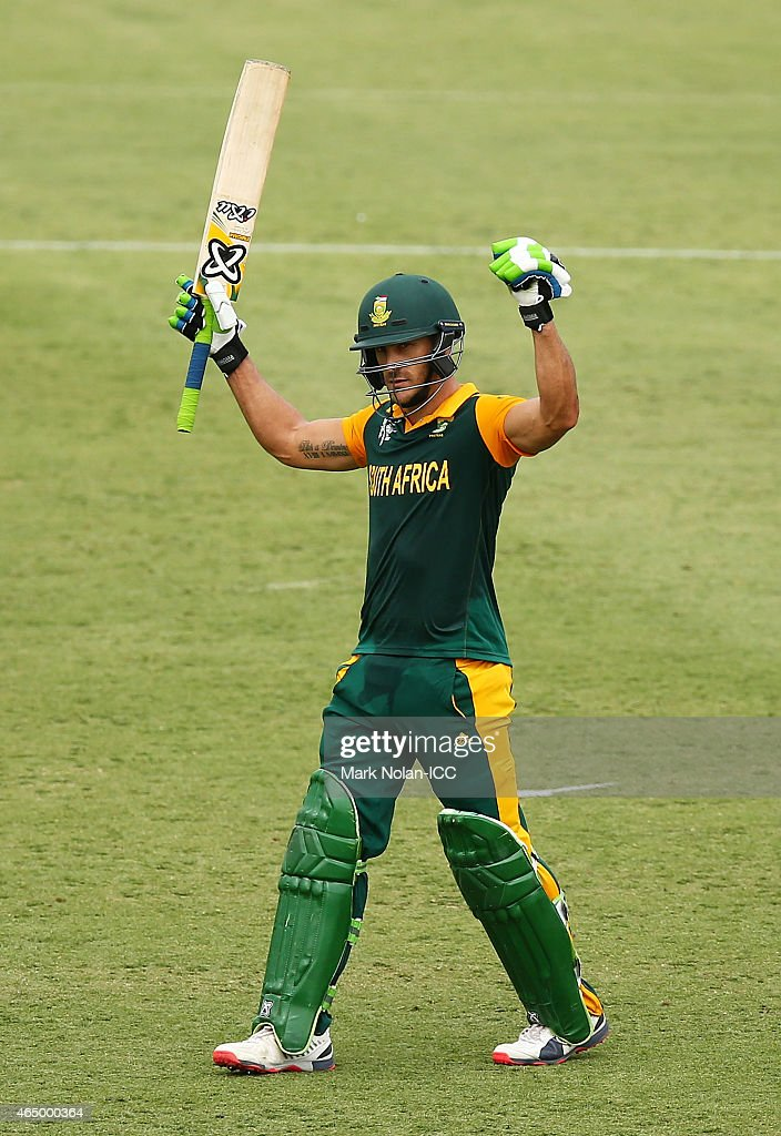 Francois Du Plessis celebrates scoring a century during the 2015 ICC Cricket World Cup match between South Africa and Ireland at Manuka Oval on March 3, 2015 in Canberra, Australia.