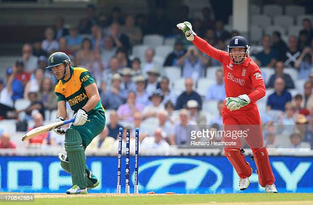 Francois Du Plessis of South Africa is caught out by Jos Buttler of England during the ICC Champions Trophy Semi Final match between England and...