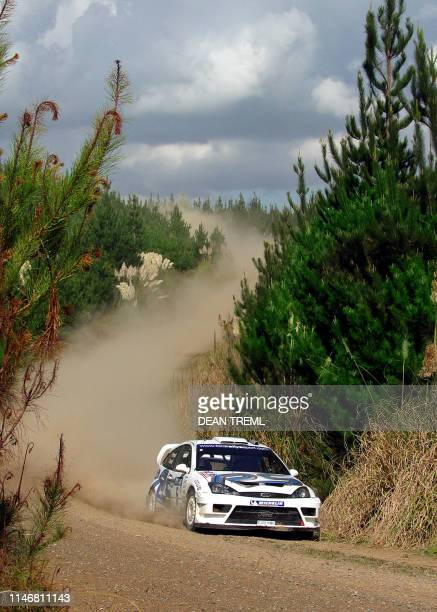 Francois Duval of Belgium and his codriver Stephane Prevot in their Ford Focus RS WRC 03 wind their way through special stage 21 on their way to an...