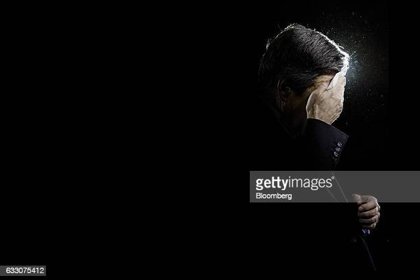 Francois Fillon France's presidential candidate wipes his brow on stage during an election campaign meeting in Paris France on Sunday Jan 29 2017...