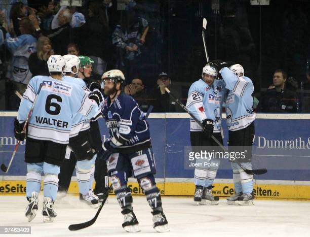 Francois Fortier of Hamburg celebrates with his team mates after scoring his team's first goal during the DEL match between Hamburg Freezers and...
