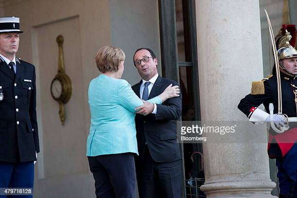 Francois Hollande France's president right embraces Angela Merkel Germany's chancellor as she departs Elysee Palace following a meeting in Paris...