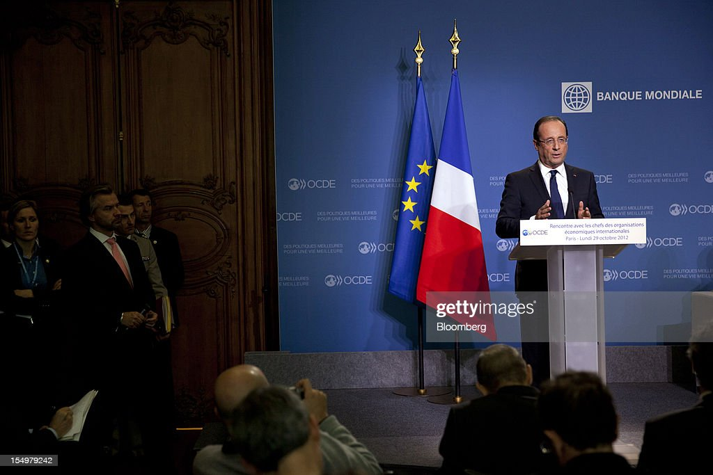 Francois Hollande, France's president, right, speaks during a news conference following a meeting hosted by the Organization for Economic Cooperation and Development (OECD) in Paris, France, on Monday, Oct. 29, 2012. Hollande said he wants the euro group of finance ministers to find a 'durable' solution to Greece's debt problems at their November meeting. Photographer: Balint Porneczi/Bloomberg via Getty Images
