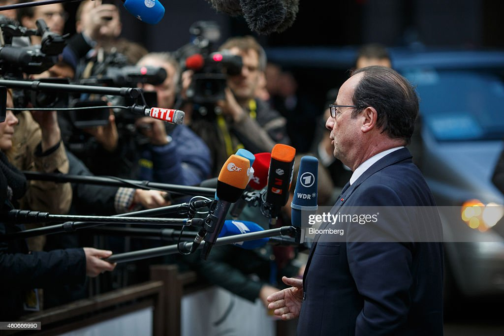 Francois Hollande, France's president, speaks to journalists as he arrives for a European Union (EU) summit meeting in Brussels, Belgium, on Thursday, Dec. 18, 2014. The EU outlawed the sale of some energy-exploration equipment to Crimea, seeking to prevent Russia from using the newly annexed Ukrainian peninsula to exploit Black Sea oil and gas deposits. Photographer: Jasper Juinen/Bloomberg via Getty Images