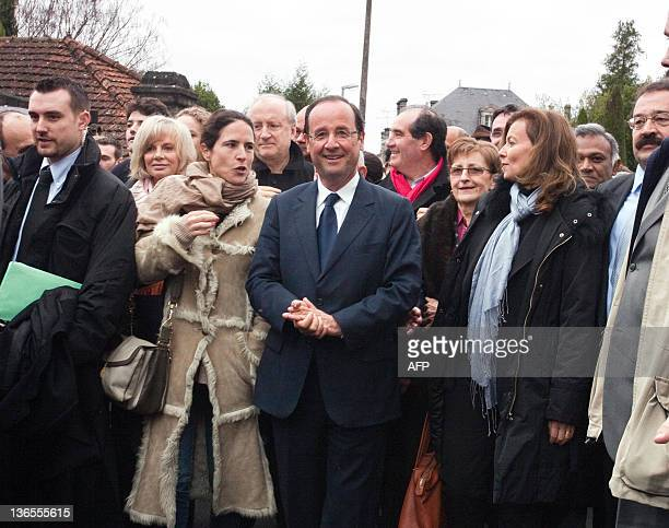 Francois Hollande France's Socialist Party candidate for the 2012 French presidential election flanked by his partner Valérie Trierweiler and the...