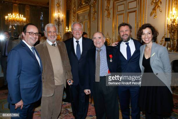 Francois Hollande JeanPaul Belmondo Christian Cambon Claude Brasseur his son Alexandre Brasseur and French Minister of Culture and Communication...