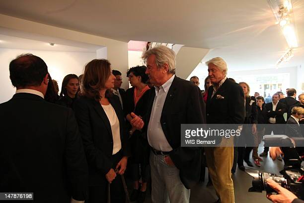 Francois Hollande Valerie Trierweiler and Alain Delon attend the opening of the exhibition of Florence Cassez the French citizen emprisoned in Mexico