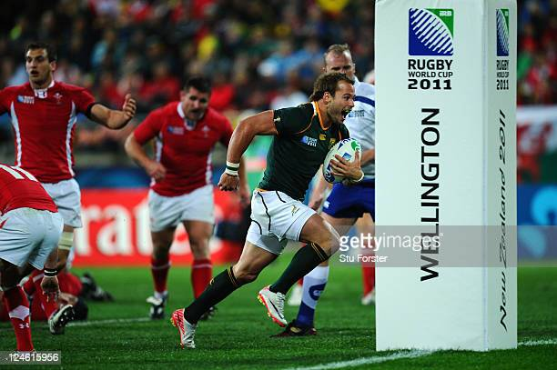 Francois Hougaard of South Africa celebrates as he crosses the line to score his team's second try during the IRB 2011 Rugby World Cup Pool D match...