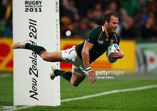 Francois Hougaard of South Africa goes over to score his second and the Springboks twelfth try during the IRB 2011 Rugby World Cup Pool B match...