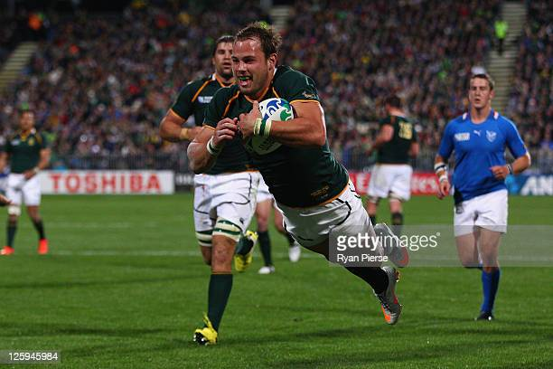 Francois Hougaard of South Africa goes over to score their nineth try during the IRB 2011 Rugby World Cup Pool B match between South Africa and...