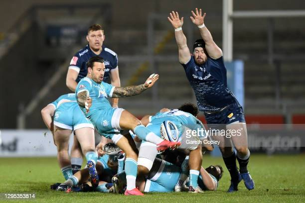 Francois Hougaard of Worcester kicks up field as Bevan Rodd of Sale tries to block during the Gallagher Premiership Rugby match between Sale Sharks...