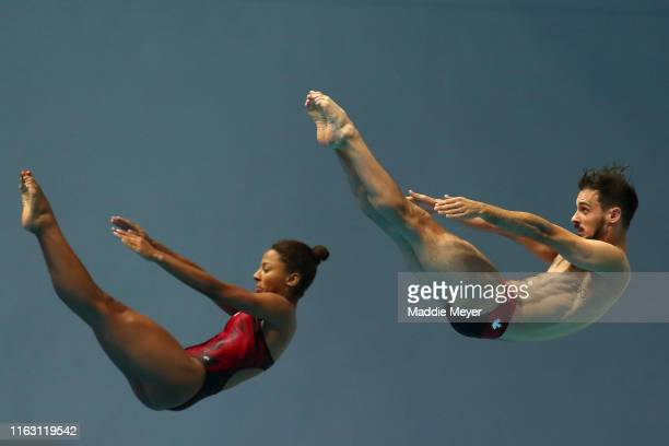 Francois ImbeauDulac and Jennifer Abel of Canada compete in the Mixed 3m Synchro Springboard Final during day nine of the Gwangju 2019 FINA World...