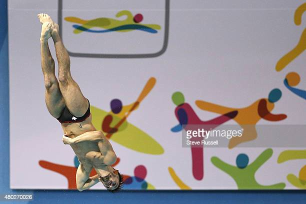 TORONTO ON JULY 10 Francois ImbeauDulac of Canada preforms a forward 2 1/2 somersault with 3 twists in the pike position in the men's 3 metre...