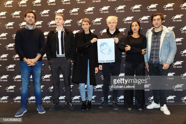 Francois JAros Finnegan Oldfield Delphine Lehericey Thomas Mustin Nadia Kounda and Sebastien Houbani members of Short Films Jury hold a photo of the...