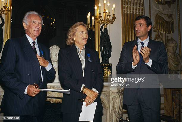 Francois Leotard the French Minister of Culture presents the Ordre du Merite des Arts et Lettres to television producers Maritie and Gilbert...