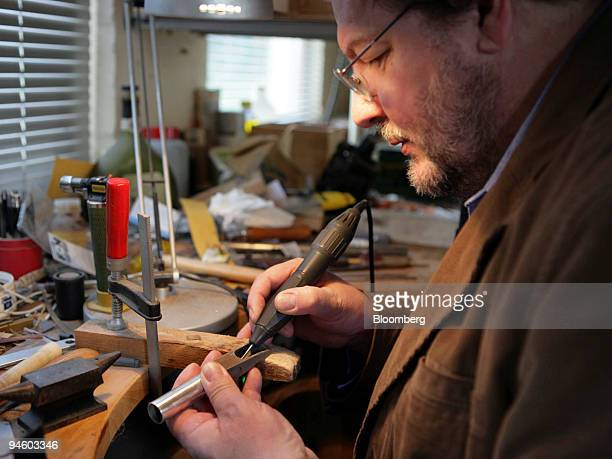 Francois Louis works on the mouthpiece of an Aulochrome in his studio in Ciplet, Belgium, Wednesday, November 1, 2006. Louis, the inventor of a...