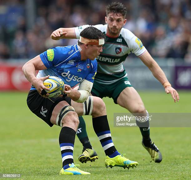 Francois Louw of Bath holds onto the ball as Owen Williams looks on during the Aviva Premiership match between Bath and Leicester Tigers at the...