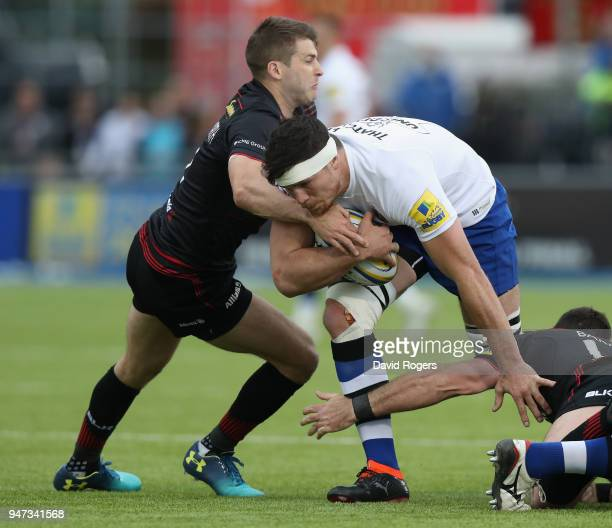 Francois Louw of Bath is tackled by Richard Wigglesworth during the Aviva Premiership match between Saracens and Bath Rugby at Allianz Park on April...
