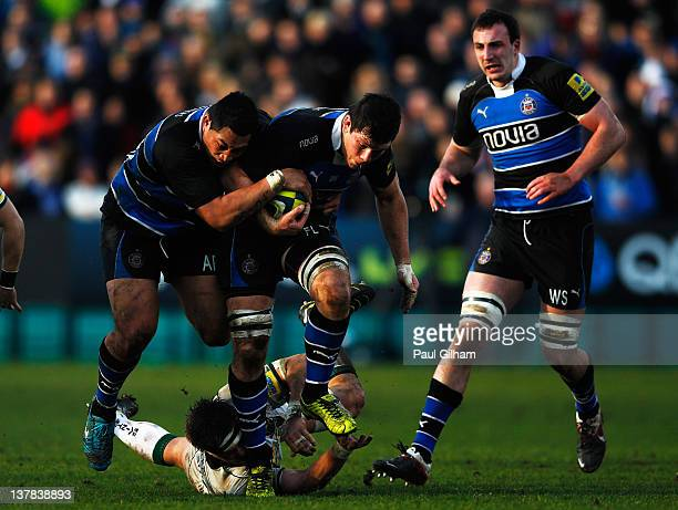 Francois Louw of Bath Rugby is helped by his teammate Anthony Perenise as he evades the challenge of Alex Waller of Northampton Saint during the LV...