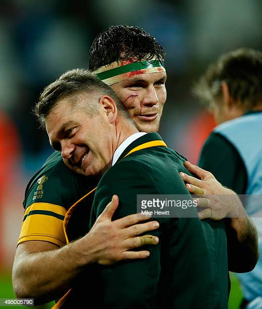 Francois Louw of South Africa hugs Heyneke Meyer Head Coach of South Africa after the 2015 Rugby World Cup Bronze Final match between South Africa...