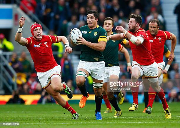 Francois Louw of South Africa is tackled by Alex Cuthbert of Wales during the 2015 Rugby World Cup Quarter Final match between South Africa and Wales...