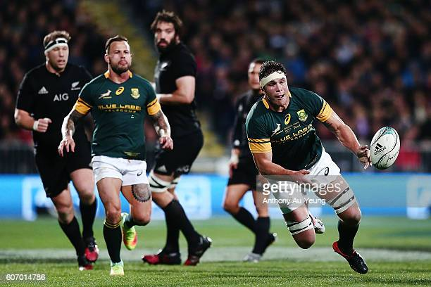Francois Louw of South Africa with a pass during the Rugby Championship match between the New Zealand All Blacks and the South Africa Springboks at...