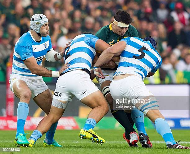 Francois Louw of the Springbok Team is tackled by Argentina players during The Rugby Championship match between South Africa and Argentina at...
