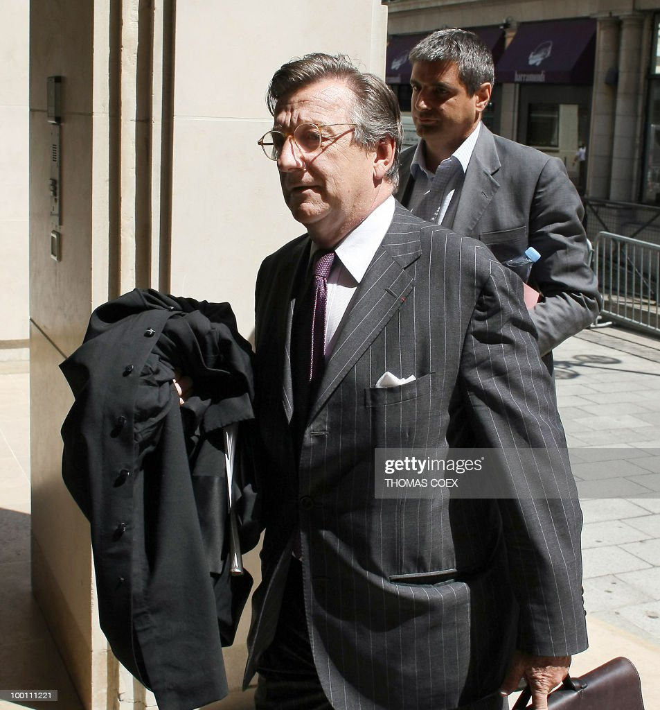Francois Martineau (R), lawyer of Christophe Mannie (R), director of French bank Societe Generale's (SG) corporate and investistment banking branch is pictured, on July 23, 2008 in Paris, as he arrives at the financial investigation unit of Paris courthouse prior to a hearing between his client and SG rogue trader Jerome Kerviel as part of the inquiry into the Societe Generale's multi-billion-euro losses. Kerviel, 31, was involved in deals which the French bank says cost more than seven billion dollars in the biggest known rogue trading scam.