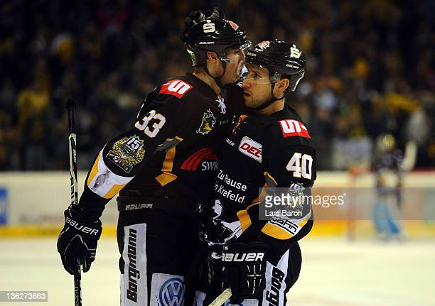 Francois Methot of Krefeld celebrates with team mate Pascal Zerressen after scoring his teams third goal during the DEL match between Krefeld...