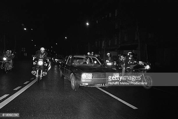 Francois Mitterrand arrives victoriously in Paris from ChateauChinon with his wife Danielle to celebrate his election as French President