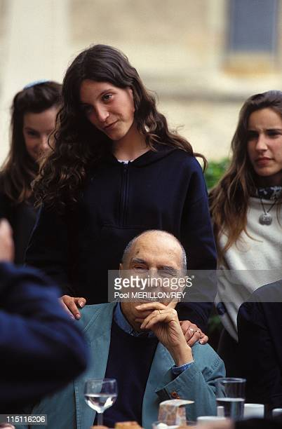 Francois Mitterrand in Solutre France on June 04 1995 Francois Mitterrand and the young woman with her hands on Mitterrand's shoulders in the picture...