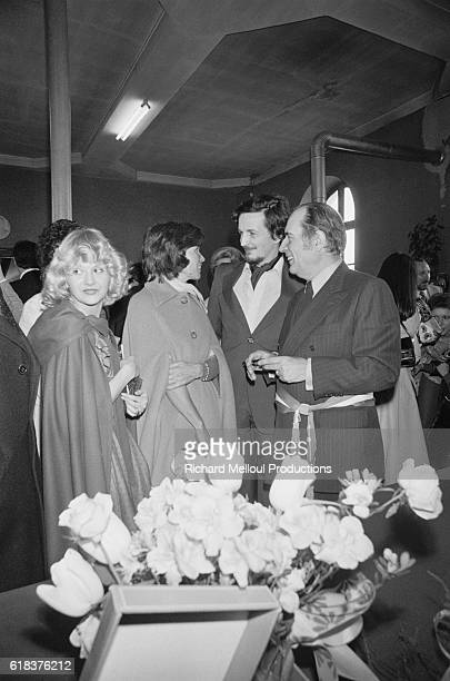 Francois Mitterrand leader of the French Socialist Party chats with a guest at the wedding of his son JeanChristophe to Elisabeth Dupuy Mitterrand...