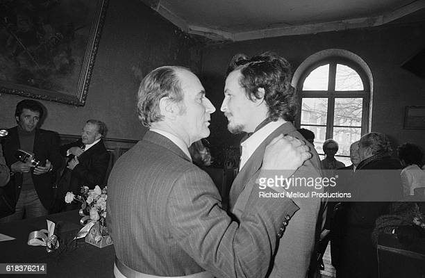 Francois Mitterrand leader of the French Socialist Party talks with his son JeanChristophe during JeanChristophe's marriage to Elisabeth Dupuy...