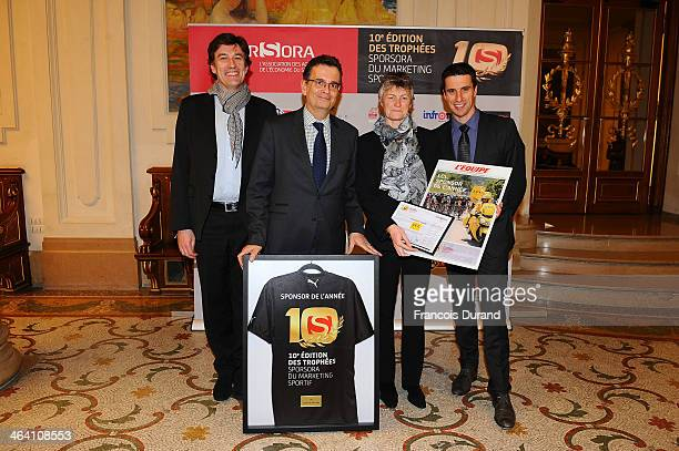 Francois Moriniere PierrePaul Cochet Sophie MoresseePichot and Olympic athlete Tony Estanguet pose for a photo as they attend the 'Trophees Sporsora...