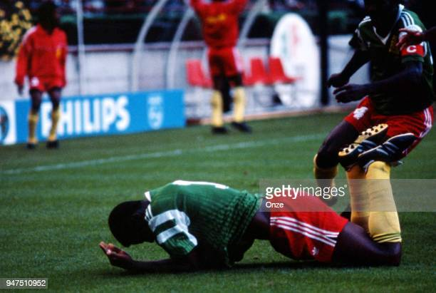 Francois Omam Biyik of Cameroon celebrate after scoring a goal during the opening match of the 1990 World Cup between Cameroon and Argentina at Stade...