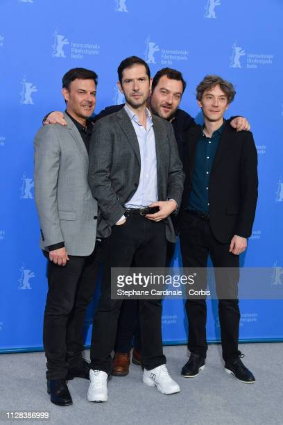 Francois Ozon Melvil Poupaud Denis Menochet and Swann Arlaud pose at the Grace A Dieu photocall during the 69th Berlinale International Film Festival...