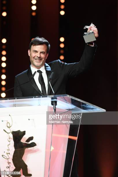 Francois Ozon winner of the Silver Bear Grand Jury Prize for By the Grace of God is seen on stage at the closing ceremony of the 69th Berlinale...