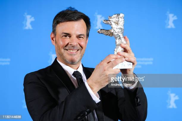 Francois Ozon winner of the Silver Bear Grand Jury Prize for By the Grace of God poses backstage at the closing ceremony of the 69th Berlinale...