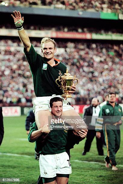 Francois Pienaar with trophy and Hennie Le Roux celebrate South Africa's victory in the 1995 Rugby Union World Cup over New Zealand