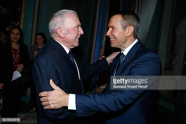"""Francois Pinault and Artist Jeff Koons attend the Press conference announcing a donation by artist Jeff Koons who offers the """"Bouquet of Tulips"""" to..."""