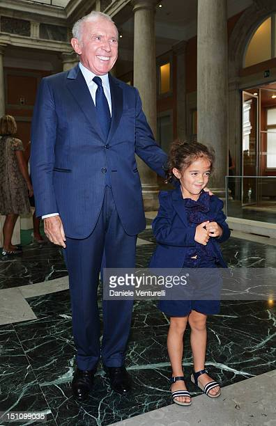 """Francois Pinault and his grand-daughter Valentina Pinault attend the """"La Voce Delle Immagini"""" Exhibition at the Palazzo Grassi on September 1, 2012..."""