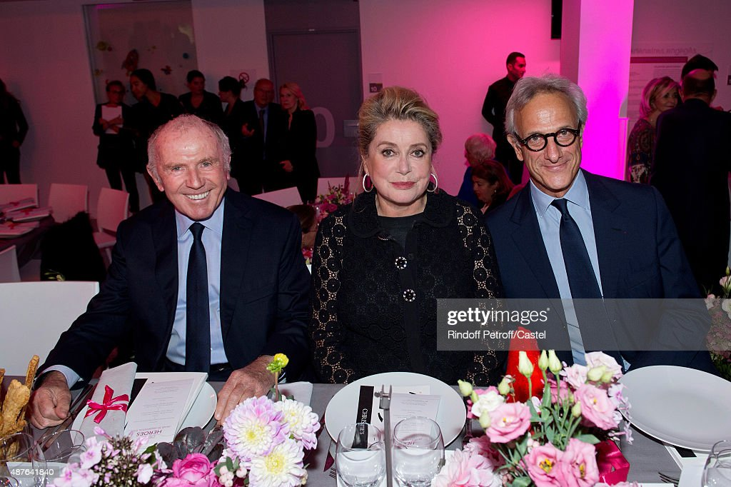 Francois Pinault, Catherine Deneuve and Francois de Ricqles attend the Auction Dinner to Benefit 'Institiut Imagine' on September 10, 2015 in Paris, France.