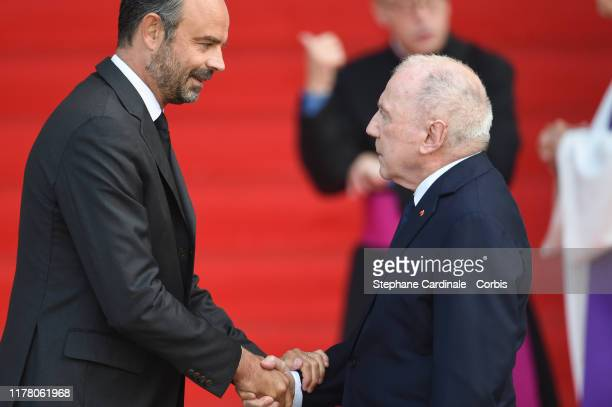 Francois Pinault is greeted by France's Prime Minister Edouard Philippe as he arrives to attend a church service for former French President Jacques...
